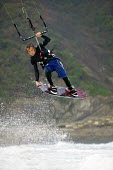 A kitesurfer performing jumps, at Parr Sands in Cornwall. - Paul Box - 16-10-2006