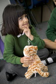 Pupils being taught about the learning method, of 7 Dimensional Learning using puppets. At Westbury Park Primary School, in Bristol. - Paul Box - 2000s,2006,and,attention,attentive,BME minority ethnic,cat,cats,child,CHILDHOOD,children,cities,city,class,classes,classroom,classrooms,cuddly,curiosity,device,devices,dimensional,edu education,educat