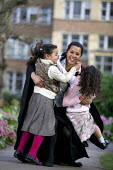 A student on Graduation Day at Bristol University, with her children. - Paul Box - ,2000s,2007,academic,academical,ACADEMICS,adult,Adult Education,adults,associated,BME Black minority ethnic,building,buildings,candidate,candidates,celebrate,celebrates,celebratin,CELEBRATING,ceremoni