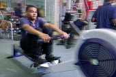 Pupil exercising at the gym, The City Academy Bristol - Paul Box - 2000s,2006,academies,Academy,Aerobic,arm,arms,BME Black minority ethnic,bodybuilding,child,CHILDHOOD,children,cities,city,edu education,equipment,equipments,exercise,exercises,exercising,face,faces,fe