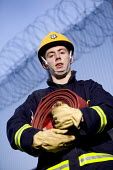 Firefighters training - Paul Box - 2000s,2007,adult,adults,down,equipment,Fire and Rescue,fire brigade,fire service,firefighter,firefighters,firehose,firehoses,fireman,firemen,held,helmet,helmets,holding,hose,hoses,LAB LBR Work,look,lo