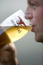 A man drinking a pint of Felinfoel welsh bitter. - Paul Box - 2000s,2007,A,ADDICTION,ADDICTIVE,alcohol,alcoholic,ALCOHOLICS,ALCOHOLISM,ale,ales,Beer,beers,beverage,beverages,bitter,bitters,Brewery,Classic,Dragon,drink,drinker,drinkers,drinking,drinks,Felinfoel,g