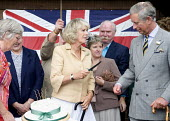 Camilla, The Duchess of Cornwall and Prince Charles celebrating her 60th birthday at Bromham, Wiltshire. - Paul Box - 2000s,2007,ace culture,adult,adults,birthday,birthdays,cake,cakes,Camilla,Camilla Parker Bowles,celebrate,celebrates,celebrating,celebrities,celebrity,couple,COUPLES,cuts,cutting,Duchess of Cornwall,F