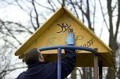 St Andrews park, Bristol. A council worker from Bristol Parks Playground Inspector team cleans graffiti and tagging off playground equipment. - Paul Box - 02-03-2008