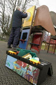 St Andrews park, Bristol. A worker from Bristol City Council Parks Playground Inspection team cleans graffiti and tagging off playground equipment. - Paul Box - 02-03-2008