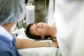 An expecting mother, undergoing a caesarean section. At South Warwickshire General Hospital. - Paul Box - 2000s,2008,adult,adults,bed,beds,birth,caesarean,caesarean c-section,caesarian,cap,caps,care,cesarean,cesarian,cesarian caesarian,Childbirth,c-section,doctor,doctors,EMOTION,EMOTIONAL,EMOTIONS,employe