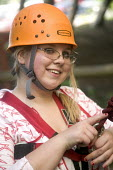 Young people taking part in an activity week at PGL Osmington Bay Centre in Weymouth. - Paul Box - 2000s,2007,Abseil,Abseiling,activities,Activity,adolescence,adolescent,adolescents,adventure,adventurecourse,Bay,camp,camps,Climbing,Connexions,course,courses,dangerous,descender,descenders,developm