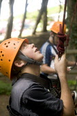 Young people taking part in an activity week at PGL Osmington Bay Centre in Weymouth. - Paul Box - 2000s,2007,Abseil,Abseiling,activities,Activity,adolescence,adolescent,adolescents,adventure,adventurecourse,Bay,boy,boys,camp,camps,child,CHILDHOOD,children,Climbing,Connexions,course,courses,dange