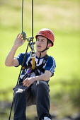 Young people taking part in an activity week at PGL Osmington Bay Centre in Weymouth. - Paul Box - 2000s,2007,Abseil,Abseiling,activities,activity,adolescence,adolescent,adolescents,adventure,adventurecourse,ascend,ascended,ascending,Bay,boy,boys,camp,camps,child,CHILDHOOD,children,Climbing,Conne