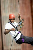 Young people taking part in an activity week at PGL Osmington Bay Centre in Weymouth. - Paul Box - 2000s,2007,Abseil,Abseiling,activities,activity,adolescence,adolescent,adolescents,adventure,adventurecourse,ascend,ascended,ascending,Bay,BME Black minority ethnic,boy,boys,camp,camps,child,CHILDHO