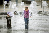 Childen playing in water fountains, outside a Asda supermarket. - Paul Box - 25-06-2005