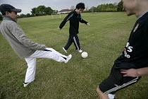 Teenagers playing football. - Paul Box - 25-06-2005