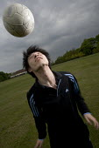 Teenager playing football. - Paul Box - 25-06-2005
