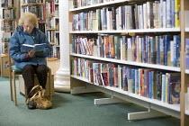 A woman reading at Preston Library. - Paul Box - 25-06-2005