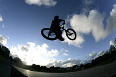 A boy performing BMX tricks at a Skate Park, in Preston. - Paul Box - (Bicycle,2000s,2005,adolescence,adolescent,adolescents,bicycle,bicycles,BICYCLING,Bicyclist,Bicyclists,bike,bikes,BMX,BMXs,boy,boys,child,CHILDHOOD,children,cities,city,cycle,cycles,cycling,cyclist,cy