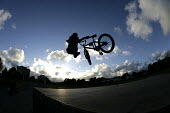 A boy performing BMX tricks at a Skate Park, in Preston. - Paul Box - ,2000s,2005,adolescence,adolescent,adolescents,bicycle,bicycles,BICYCLING,Bicyclist,Bicyclists,bike,bikes,BMX,BMXs,boy,boys,child,CHILDHOOD,children,cities,city,cycle,cycles,cycling,cyclist,cyclists,e