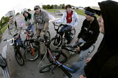 A group of friends on their BMXs at Llanlishen Skate Park, in Cardiff. - Paul Box - (Bicycle,2000s,2005,adolescence,adolescent,adolescents,basketball,bicycle,bicycles,BICYCLING,Bicyclist,Bicyclists,bike,bikes,BMX,BMXs,boy,boys,cap,caps,child,CHILDHOOD,children,cities,city,cycle,cycle