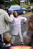 Child playing with a hoop, allotment, Butetown, Cardiff - Paul Box - 22-05-2005