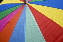 A colourful umbrella. - Paul Box - 2000s,2005,cities,city,COLOR,colorful,colorfull,colors,colour,colourful,colours,precipitation,protection,rain,raining,umbrella,umbrellas,urban,wales,wea weather,weather,welsh
