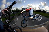 Boys performing BMX tricks at Llanlishen Skate Park, in Cardiff. - Paul Box - 23-05-2005