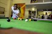 Teenagers playing snooker at Butetown Youth Centre, in Cardiff. - Paul Box - 2000s,2005,adolescence,adolescent,adolescents,ball,balls,BME Black minority ethnic,boy,boys,centre,centres,child,CHILDHOOD,children,cities,city,club,clubs,communities,community,Council Services,Counci