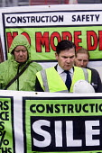 Construction safety campaign hold a silent vigil outside Simons development construction site, Witney, Oxfordshire.To show respect to Altin Balla who died when a cherry picker collapsed with him on it... - Paul Box - 09-09-2008