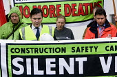 Construction safety campaign hold a silent vigil outside Simons development construction site, Witney, Oxfordshire.To show respect to Altin Balla who died when a cherry picker collapsed with him on it... - Paul Box - 2000s,2008,activist,activists,BUILDING,BUILDINGS,CAMPAIGN,campaigner,campaigners,CAMPAIGNING,CAMPAIGNS,constr,construction,Construction Industry,death,deaths,DEMONSTRATING,demonstration,DEMONSTRATIONS
