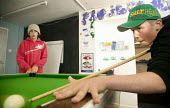 Young people playing pool at a independent youth project centre, Project Milford in Wales. - Paul Box - 27-08-2008