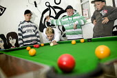 Young people playing pool at a independent youth project centre, Project Milford in Wales. - Paul Box - 2000s,2008,adolescence,adolescent,adolescents,ball,balls,billiard,billiards,bleached,boy,boys,centre,centres,child,CHILDHOOD,children,clubs,cue,cues,dyed,friend,friends,friendship,friendships,game,gam