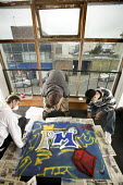 Young people creating posters with spray paint, at Project Milford in Wales. - Paul Box - 27-08-2008