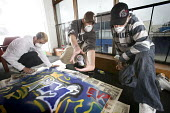 Young people creating posters with spray paint, Project Milford, Wales - Paul Box - 27-08-2008