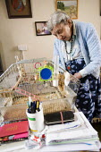 A one hundred year old lady who still lives at home on her own, with her pet budgie. - Paul Box - 2000s,2008,adult,adults,age,ageing population,bird,birdcage,birdcages,birds,Budgerigar,Budgerigars,budgie,budgies,caged,cities,city,elderly,EMOTION,EMOTIONAL,EMOTIONS,EQUALITY,excluded,exclusion,fail,