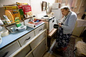 A one hundred year old lady who still lives at home on her own. - Paul Box - 2000s,2008,adult,adults,age,ageing population,ceral,cerals,cities,city,cook,COOKERY,cooking,COOKS,elderly,EQUALITY,excluded,exclusion,fail,FEMALE,frailty,HARDSHIP,home,homes,house,houses,housing,impov