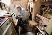 A one hundred year old lady who still lives at home on her own. - Paul Box - ,2000s,2008,adult,adults,age,ageing population,cities,city,cook,COOKERY,cooking,COOKS,elderly,EQUALITY,excluded,exclusion,fail,FEMALE,frailty,HARDSHIP,home,homes,house,houses,housing,impoverished,impo