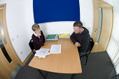 Probation service officer in the final meeting with an offender, at the end of his five-year sentence of community service. At Avon and Somerset Area Probation Office, in Weston-super-Mare. - Paul Box - 25-03-2009