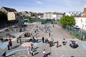 Children in the playground on their mid-morning breaktime, at Hillcrest Primary School, Bristol. - Paul Box - 29-04-2009