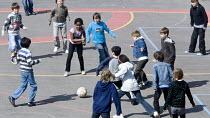 Children in the playground on their mid-morning breaktime, at Hillcrest Primary School, Bristol. - Paul Box - 2000s,2009,BAME,BAMEs,black,bme,BME minority ethnic,bmes,boy,boys,child,CHILDHOOD,children,cities,city,diversity,edu,edu education,educate,educating,education,educational,ethnicity,female,females,foot