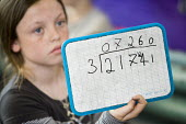 Year Five Maths lesson, at Hillcrest Primary School in Bristol. - Paul Box - ,2000s,2009,arithmetic,child,CHILDHOOD,children,cities,city,class,classroom,classrooms,communicating,communication,edu,edu education,educate,educating,education,educational,Elementary,elementary divis