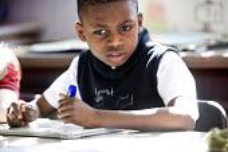 Year Five Maths lesson, at Hillcrest Primary School in Bristol. - Paul Box - 2000s,2009,arithmetic,BME Black minority ethnic,boy,boys,child,CHILDHOOD,children,cities,city,class,classroom,classrooms,edu,edu education,educate,educating,education,educational,Elementary,elementary