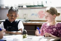 Year Five Maths lesson, at Hillcrest Primary School in Bristol. - Paul Box - ,2000s,2009,arithmetic,BAME,BAMEs,black,bme,BME Black minority ethnic,bmes,boy,boys,child,CHILDHOOD,children,cities,city,class,classroom,classrooms,diversity,edu,edu education,educate,educating,educat