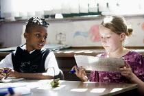 Year Five Maths lesson, at Hillcrest Primary School in Bristol. - Paul Box - 2000s,2009,arithmetic,BAME,BAMEs,black,bme,BME Black minority ethnic,bmes,boy,boys,child,CHILDHOOD,children,cities,city,class,classroom,classrooms,diversity,edu,edu education,educate,educating,educati