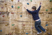 Children playing on a traversing wall, at Hillcrest Primary School, Bristol. - Paul Box - 29-04-2009
