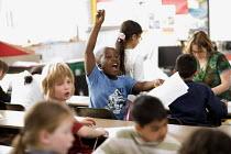 Year Four lesson at Hillcrest Primary School in Bristol. - Paul Box - ,2000s,2009,answer,answering,answers,arm,BME Black minority ethnic,BME minority ethnic,boy,boys,child,CHILDHOOD,children,cities,city,class,classroom,CLASSROOMS,communicating,communication,edu,edu educ