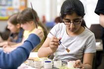 Year Six Art lesson in Hillcrest Primary School, Bristol. - Paul Box - 2000s,2009,ACE,and,art,arts,BME minority ethnic,child,CHILDHOOD,children,cities,city,class,classroom,CLASSROOMS,crafts,edu,edu education,educate,educating,education,educational,female,females,girl,gir