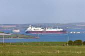 A LNG (liquefied natural gas) Q-flex tanker arriving at South Hook terminal, at Milford Haven in Pembrokeshire. - Paul Box - (LNG),2000s,2009,anchorage,ARRIVAL,arrivals,arrive,arrived,arrives,arriving,boat,boats,capitalism,capitalist,cargo,Carrier,carriers,country,countryside,deep,delivering,delivery,EBF Economy,energy,eni