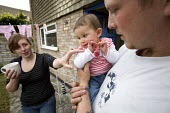 A Young family with a low income at their rented home in Weston-super-Mare. - Paul Box - ,2000s,2009,adult,adults,at,babies,baby,benefit,benefits,CARE,carer,carers,child,Child Care,childcare,CHILDHOOD,CHILDMINDING,children,council estate,council services,council estate,council services,co