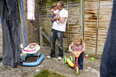 A Young family with a low income at their rented home in Weston-super-Mare. - Paul Box - 2000s,2009,at,babies,baby,benefit,benefits,bicycle,bicycles,BICYCLING,Bicyclist,Bicyclists,BIKE,BIKES,CARE,carer,carers,child,Child Care,childcare,CHILDHOOD,CHILDMINDING,children,council estate,counci