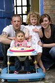 A Young family with a low income at their rented home in Weston-super-Mare. - Paul Box - 2000s,2009,adult,adults,at,babies,baby,benefit,benefits,CARE,carer,carers,child,Child Care,childcare,CHILDHOOD,CHILDMINDING,children,council estate,council services,council estate,council services,cou