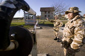 Gurkhas help train British troops at Salisbury plain in a mock afghan village to prepare them to fight insurgents in the war of occupation in Afghanistan - Paul Box - 13-02-2008