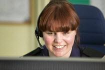Avon Fire Control Centre, Bath. - Paul Box - 2000s,2008,call centre,call centre,call centres,capitalism,centre centres,communicating,communication,control centre,control room,DIA,earphone earphones,emergency calls,emergency emergencies,emergency
